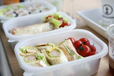 Ready made meal with sandwich wrap and tomatoes